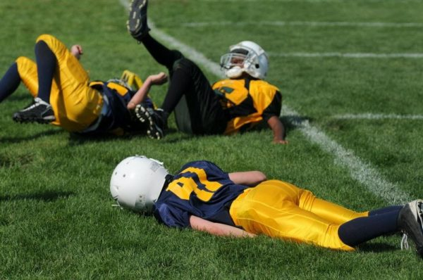 youth football players tumbling on the turf